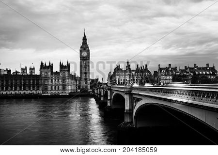 London UK. Sunset over the city of London UK. Colorful sky behind Westminster and Big Ben. Westminster bridge at night. Black and white