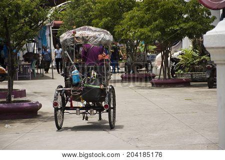 Thai People Reding Vintage Retro Tricycle Bike Or Rickshaw Of Thai Style