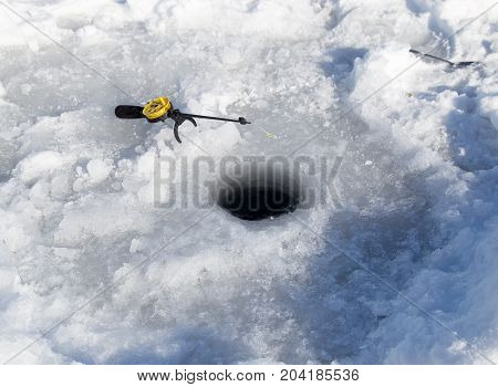 Fishing line in hole drilled in ice
