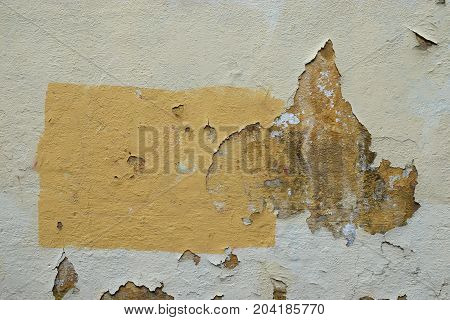 Chipped paint wall and yellow rectangle abstract background.