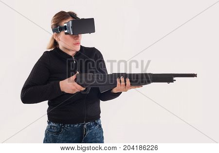 Woman Play Vr Shooter Game With Vr Glasses And Rifle
