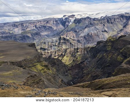 Icelandic landscape with mountains, sky and clouds. Trekking in national park Landmannalaugar.