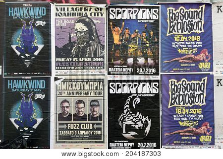 ATHENS GREECE - APRIL 9 2016: Concert posters for live music shows of hard rock by Hawkwind Scorpions Villagers of Ioannina City garage punk by Sound Explosion and the Mongrelettes and hip-hop by Imiskoubria.