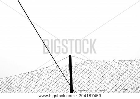 Rusty chain link fence silhouette and cable abstract background. Black and white.