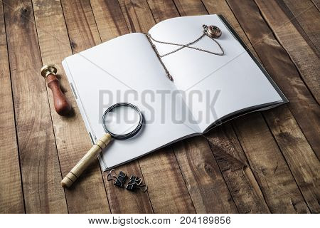 Blank opened book magnifier stamp and clock on wooden background. Responsive design template. Mock-up for your design. Top view.