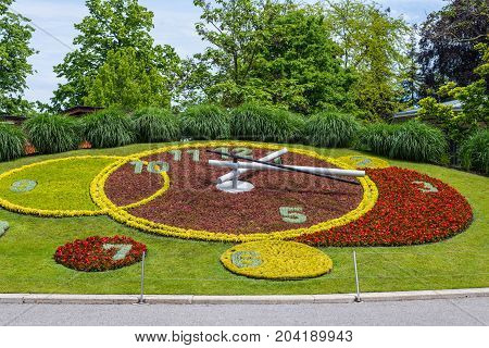 Geneva Switzerland - May 25 2016: Iconic outdoor flower clock in an urban park is one of the main attractions of the city and is a symbol of the city's watchmakers.