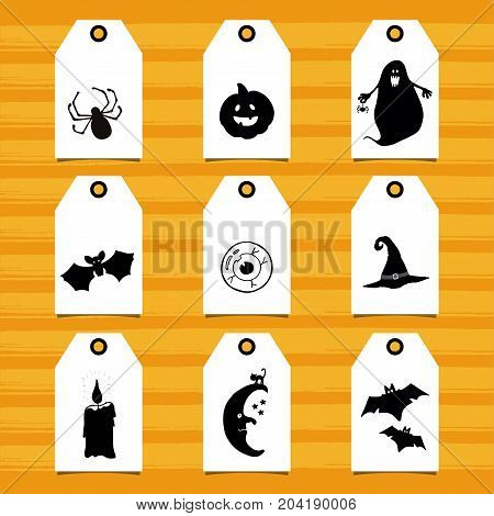 Set of tags with Halloween symbols. Hand drawn design elements on white tags for holiday decor.
