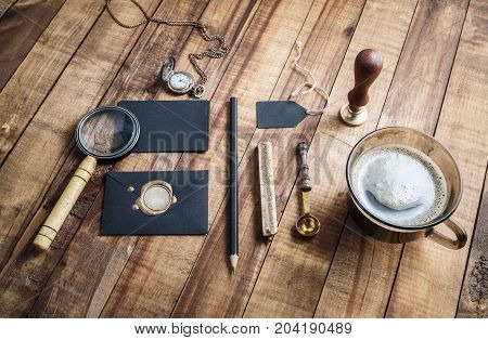Vintage stationery elements on wooden table background. Branding template. Photo of blank stationery set. Mockup for placing your design.