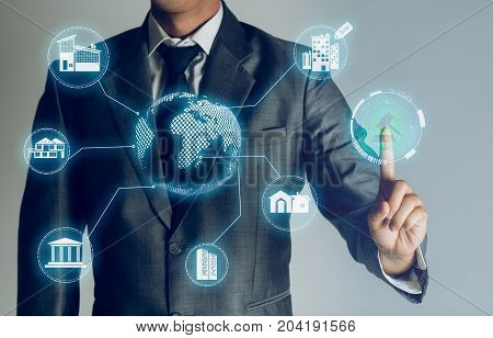 Businessman is choose online to compare location of property to buy about internet of thing concept Business investment property background.