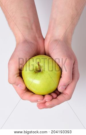 Apple In Fresh And Juicy Color. Male Hand Holds Apple