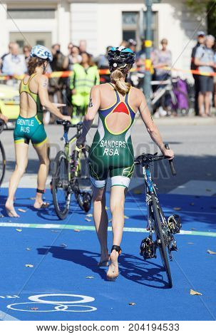 STOCKHOLM - AUG 26 2017: Back of triathlete Gillian Sanders (RSA) and Ashleig Gentle (AUS) running with cycle in the transition zone in the Women's ITU World Triathlon series event August 26 2017 in Stockholm Sweden