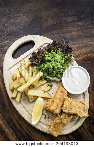 traditional fish and chips with peas and tartar sauce