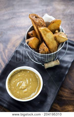 fried potato wedges with curry sauce snack food