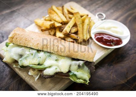 gourmet Philly Cheese steak american Sandwich with fries