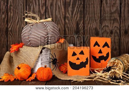 Rustic Shabby Chic Halloween Decor Against An Old Wood Background