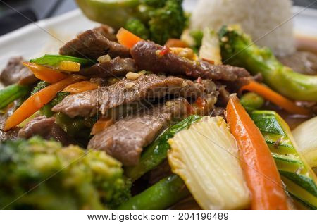 Thai beef pad pak with rice and mixed vegetables