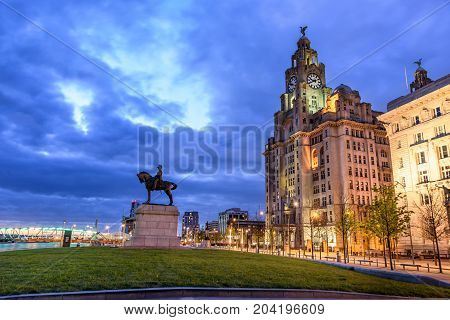The Three Graces historic buildings which dominate the Liverpool waterfront at Pier Head - Royal Liver Building Cunard Building Port of Liverpool Building.
