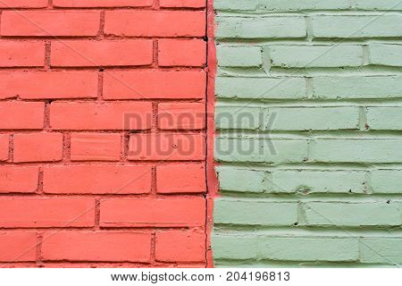 Dual toned brick wall half of it is brick red and half is light green. Colour contrasts in old buildings.
