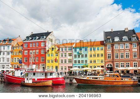 Copenhagen Denmark - August 18 2017. Famous Nyhavn pier with colorful buildings and boats in Copenhagen Denmark