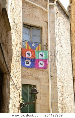 GIRONA, SPAIN - JULY 28, 2017: Flags on terrace promoting the independence of Catalonia in Girona Spain.