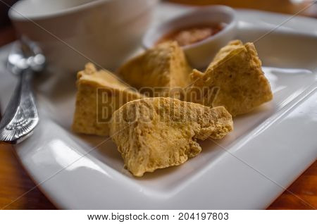 Thai deep fried tofu with peanut chili duck sauce for dipping