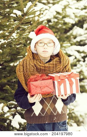 Small Boy With Present Boxes In Winter Outdoor