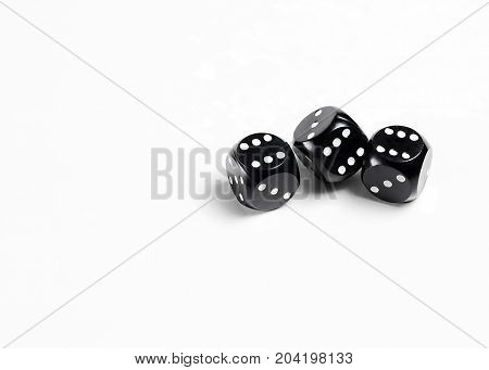 Dice on a white background. Three black dice. Gambling.