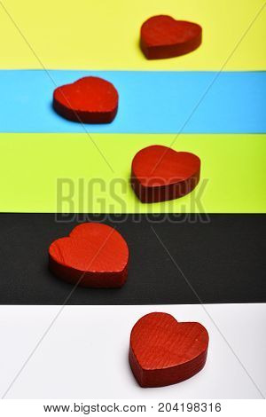 Red Wooden Hearts On Colourful Background