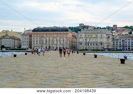 TRIESTE ITALY - AUGUST 19 2017:A view of Trieste taken at the end of the old pier Molo Audace.