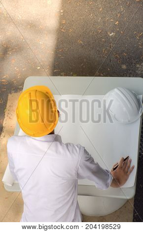 Architect working on blueprint.engineer inspector in workplace, High angle view,blueprint ,Construction industry concept.