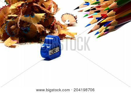 Stack Of Pencils Fraction With Pencils And Pencil Sharpener On White Background Isolated