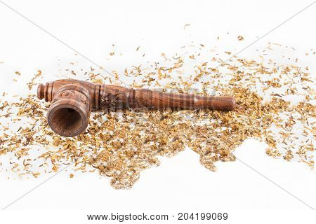 wooden pipe and tobacco around. White background.