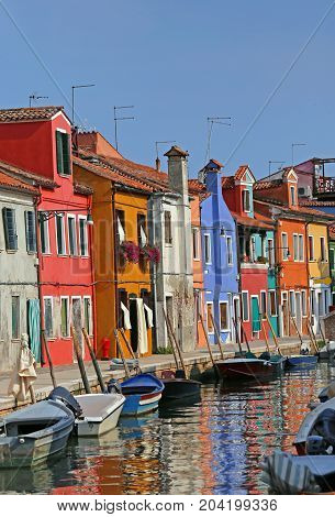 Colored Houses In The Island Of Burano In Venice And The Reflect