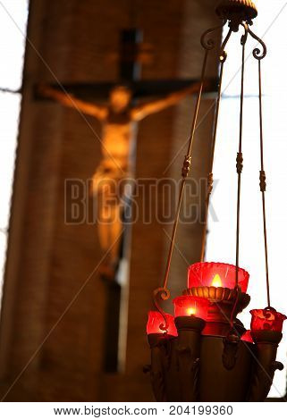 Crucifix Of A Christian Church And Candlestick With Candles