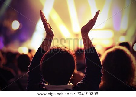 Fans While Applauding The Rock Band With Vintage Effect