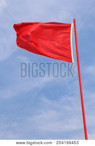 Flying Red Flag Indicating A State Of Danger And Alarm