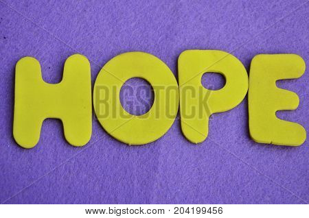 WORD HOPE ON A  ABSTRACT BLUE BACKGROUND