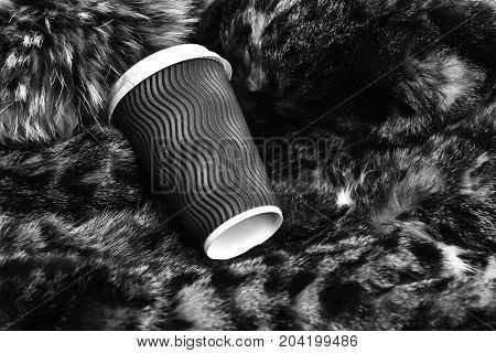 Blue Paper Or Plastic Coffee Cup On Fur Coat Background