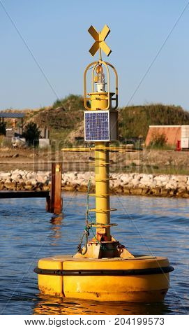 bgi yellow buoy for signaling to ships with a small photovoltaic system for flashing light