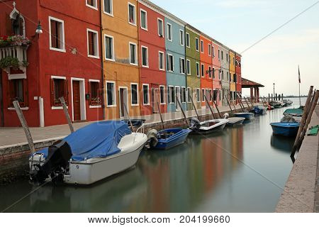 Navigable Canal And The Colorful Houses Of The Burano Island Nea