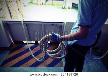 Sailor Must Launch The Rope To Moor The Ship