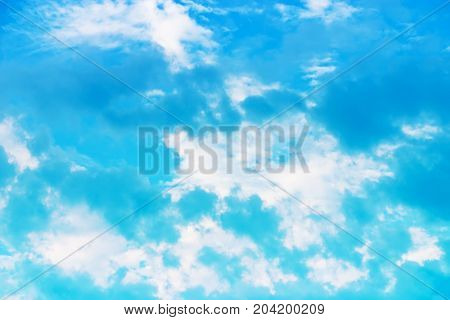 Blue sky background with clouds. Photo wallpaper