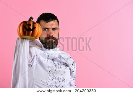 Halloween Character In White Long Sleeved Ghost Costume. Halloween Concept