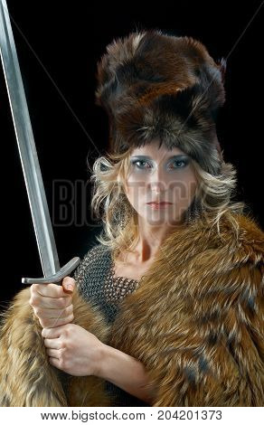 medieval Valkyrie. Viking romantic girl with sword