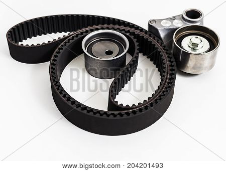 Kit of timing belt with rollers on a white background isolated. Auto Parts. Spare parts for the repair of cars.