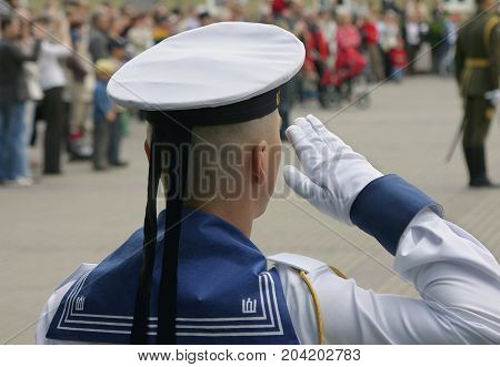 VILNIUS LITHUANIA - May 04 2008: Close-up of soldier saluting at military parade in Vilnius Lithuania