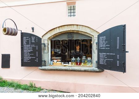 PRAGUE CZECH REPUBLIC - JUNE 27 2016: Street window cafe and bakery selling traditional pastry trdelnik in the old town of Prague Czech Republic.