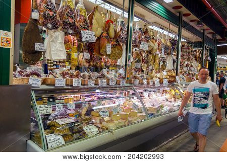 FLORENCE ITALY - JULY 12 2016: Traditional Italian meat cheese and other products for sale in the food market in Florence Italy