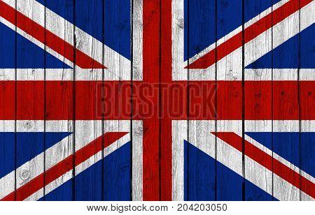 United Kingdom national flag on old weathered wood background