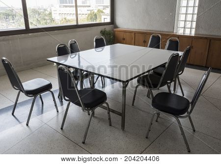 Table and metal chair set for informal conference in the morning before the office hour outside the office area.